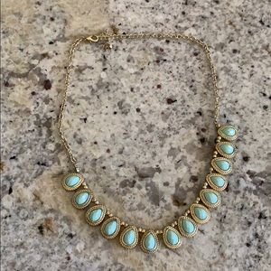 Gold tone light blue green necklace